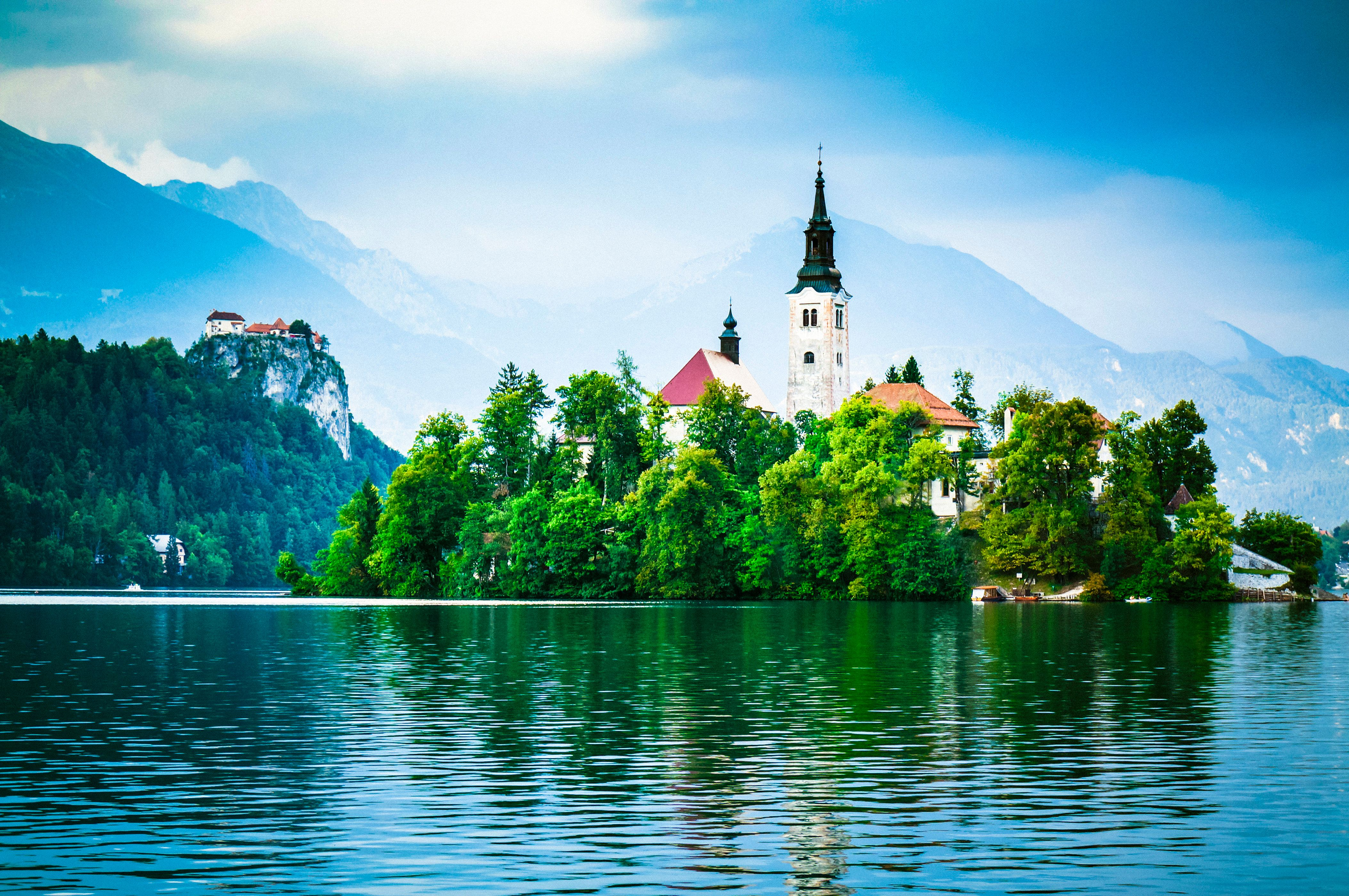"""A dramatic<a href=""""http://www.bled.si/en/what-to-see/natural-sights/the-bled-island"""" target=""""_blank"""">99-step staircase<"""