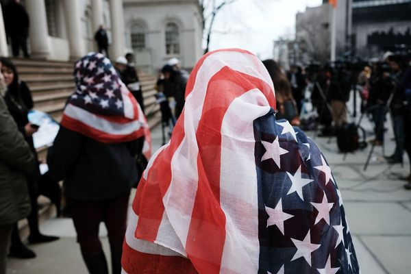 Women wear American flag head scarves at an event at city hall for World Hijab Day on Wednesday in New York City.