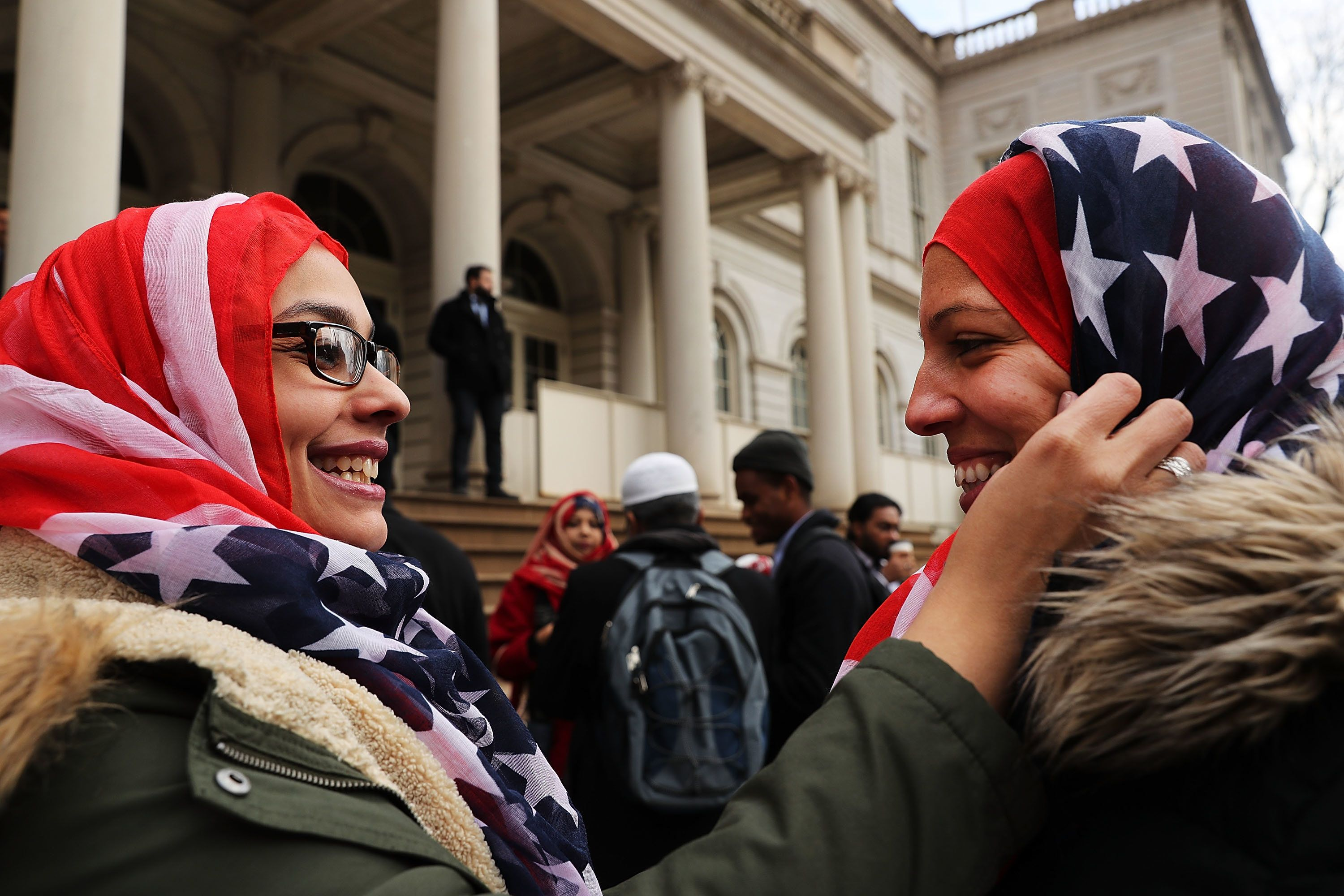 New York City Police Officers Aml Elsokary (left) and Maritza Morales wear American Flag head scarves.