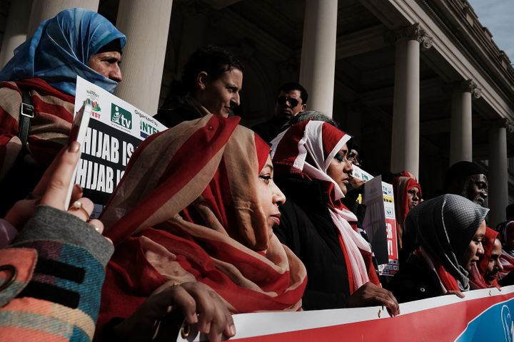 Women wear American flag hijabs at an event at City Hall for World Hijab Day on Wednesdayin New York City.