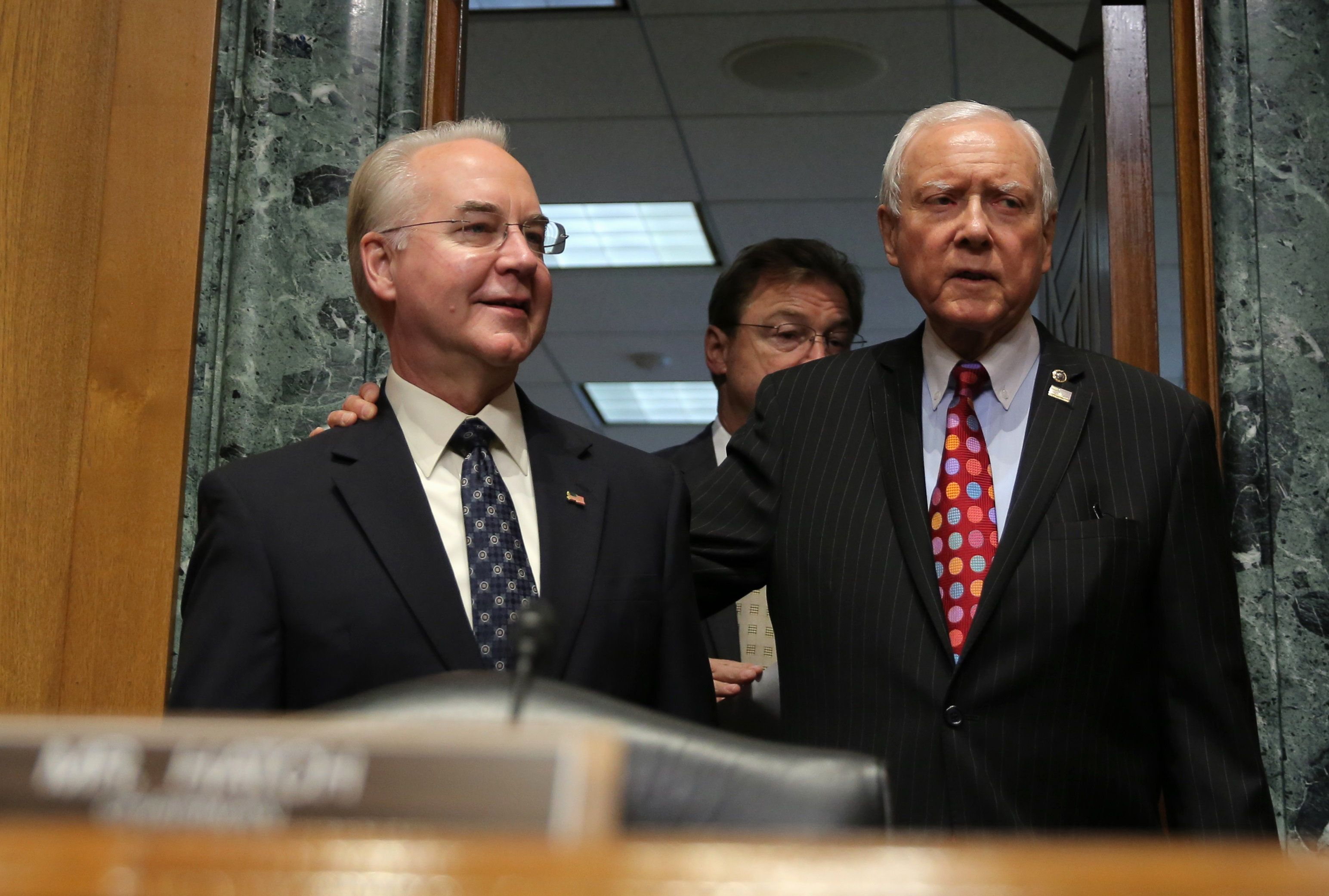 Rep. Tom Price (R-Ga.), left, is welcomed by Senate Finance Committee Chairman Orrin Hatch (R-Utah) prior to testifying befor