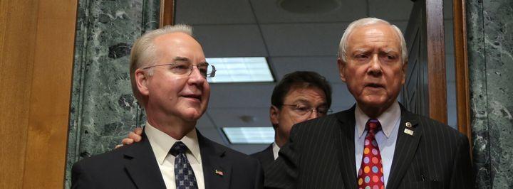 Rep. Tom Price (R-Ga.), left, is welcomed by Senate Finance Committee Chairman Orrin Hatch (R-Utah) prior to testifying befor