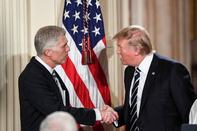 President Trump shakes the hand of Judge Neil Gorsuch during a Supreme Court of the United States nominee...