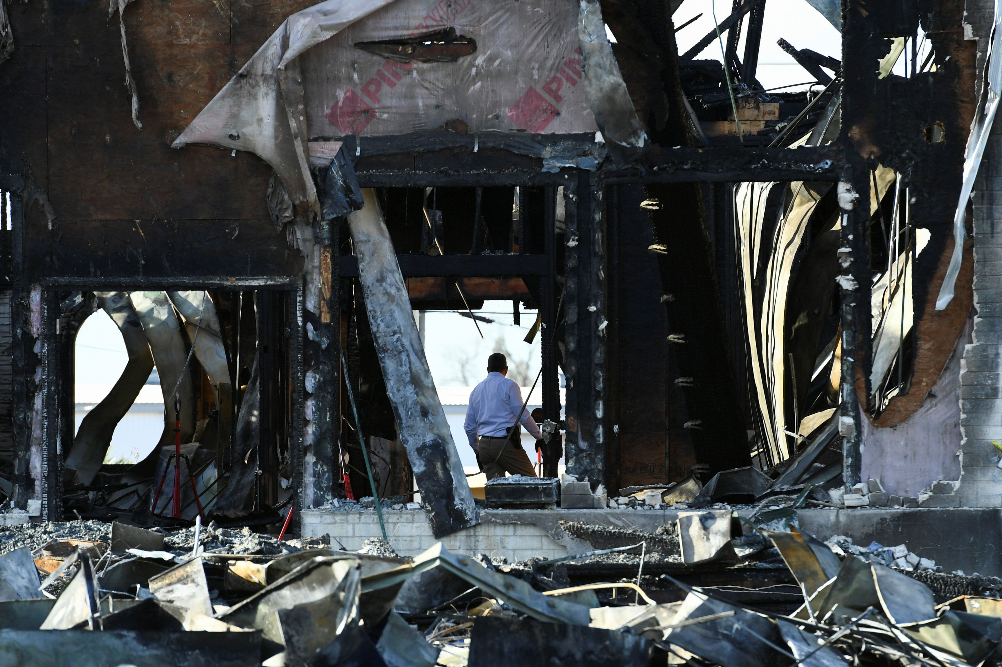 A security official investigates the aftermath of a fire at the Victoria Islamic Center mosque in Victoria, Texas January 29, 2017.  REUTERS/Mohammad Khursheed