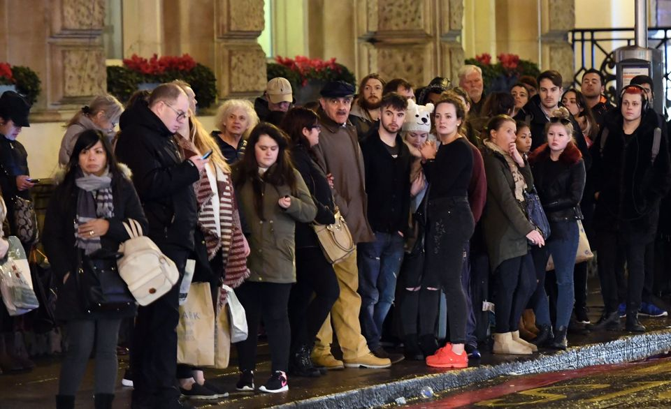 Commuters wait outside Victoria railway station station for buses at the conclusion of a 24-hour strike...