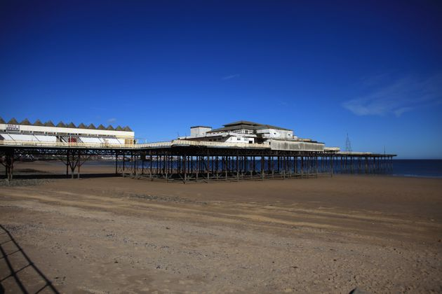 The dilapidated pier seen in