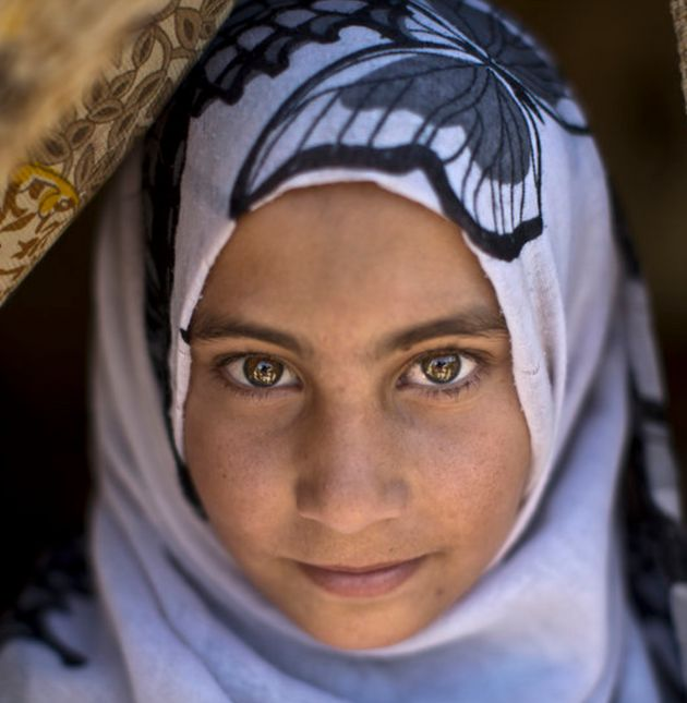 Syrian refugee Halima Ahmad in the doorway of her family's tent in the Jordan Valley,