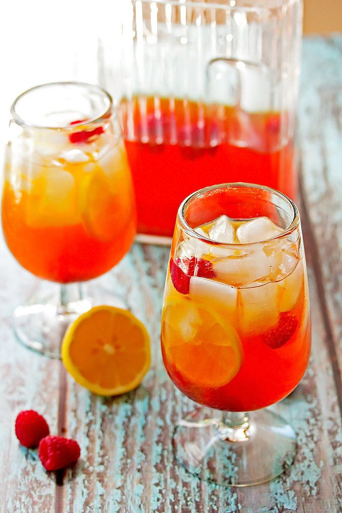 "<strong>Get the <a href=""http://cookswithcocktails.com/hard-lemon-raspberry-iced-tea/"" target=""_blank"">Hard Lemon And Raspber"