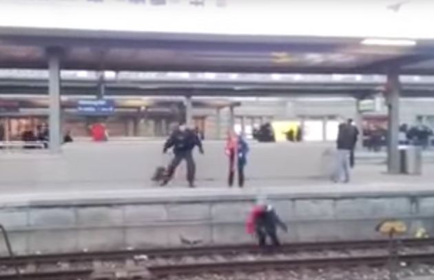 The woman was knocked onto the train tracks by a clearly agitated police