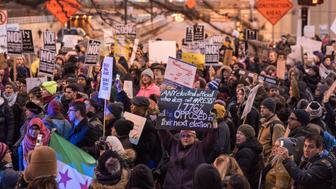 Hundreds of demonstrators in Chicago march in protest of President Trump's executive order that temporarily blocks refugees and travelers from seven predominantly Muslim countries from entering the United States on February 1, 2017. (Photo by Max Herman/NurPhoto via Getty Images)