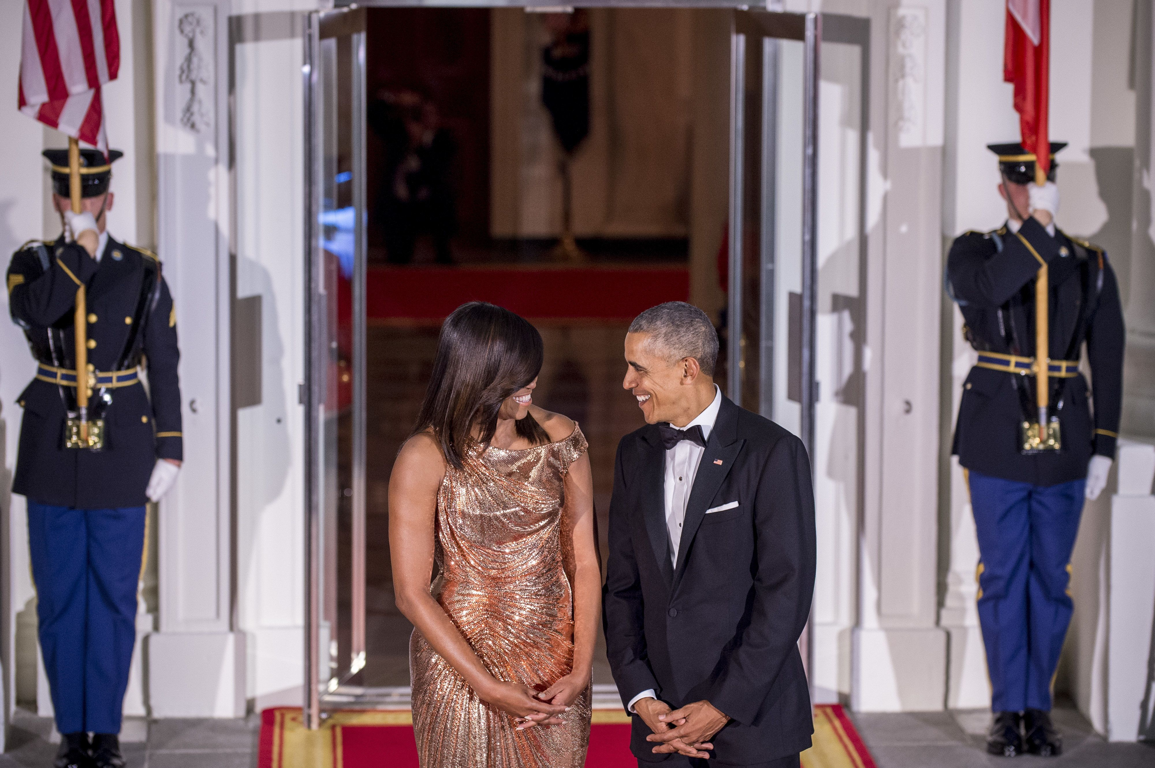 U.S. President Barack Obama, right, and First Lady Michelle Obama smile as they wait for the arrival of Matteo Renzi, Italy's prime minister, and his wife Agnese Landini on the North Portico of the White House in Washington, D.C., U.S., on Tuesday, Oct. 18, 2016. 'We are proud to call you allies and friends today and always,' U.S President Obama said as he welcomed Renzi to the White House for what he says is the last state dinner of his term. Photographer: Pete Marovich/Bloomberg via Getty Images