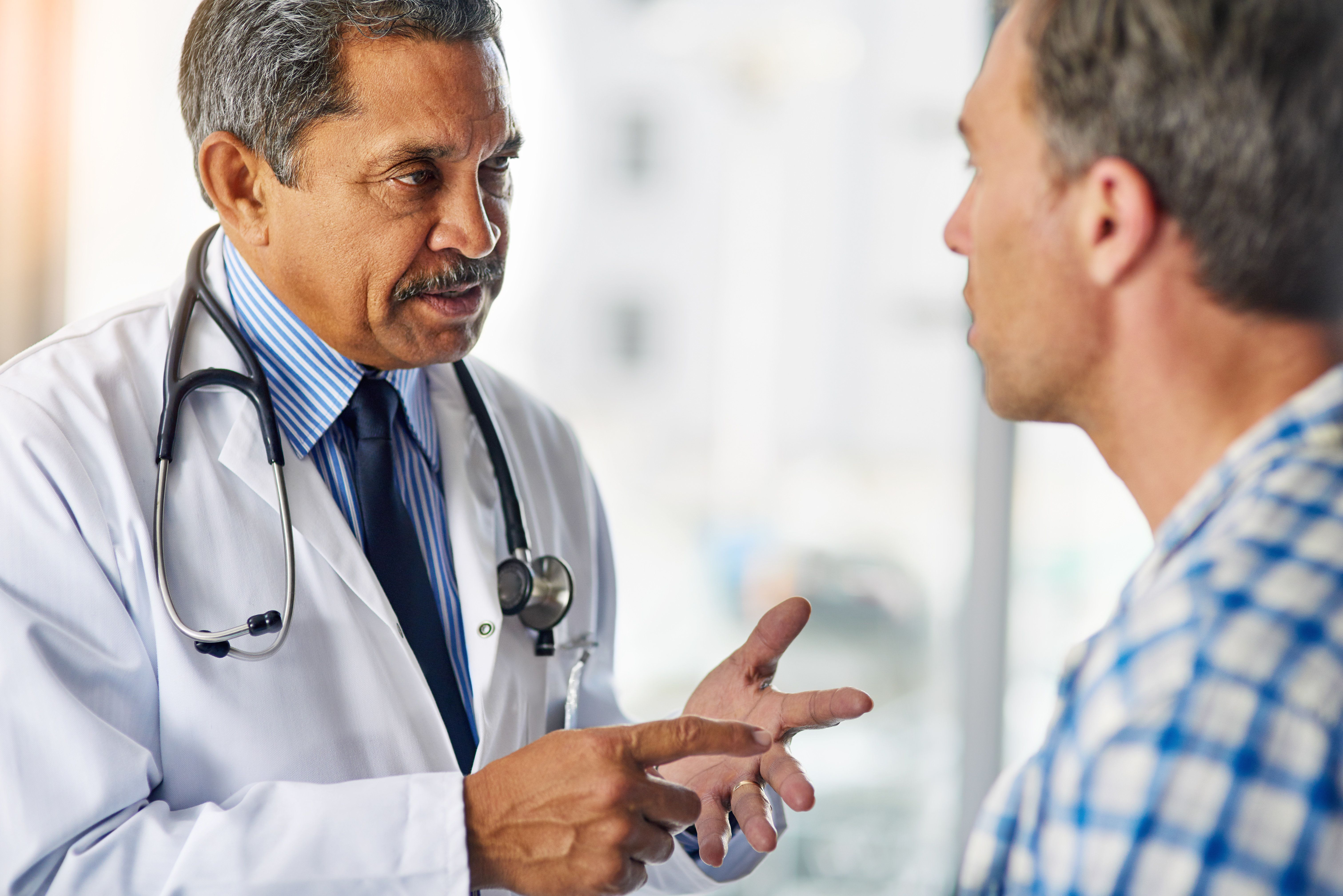 Cropped shot of a doctor a giving his patient advice during a consult