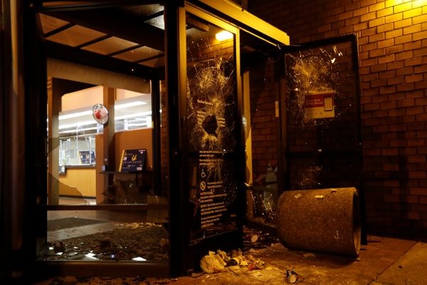 A vandalized Bank of America office is seen after a student protest turned violent.
