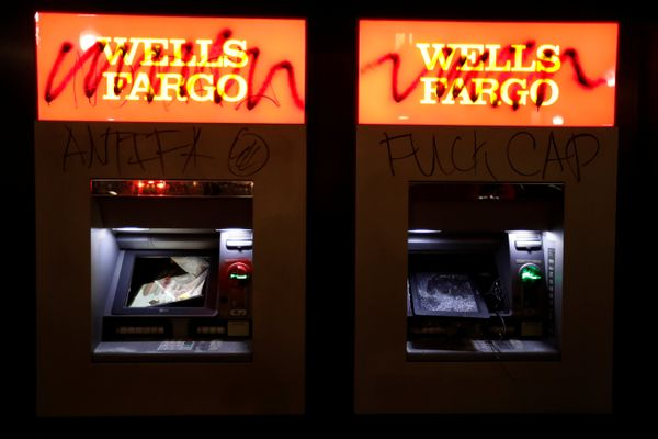 Vandalized ATMs are seen at a Wells Fargo bank after a student protest turned violent at UC Berkeley during a demonstration o