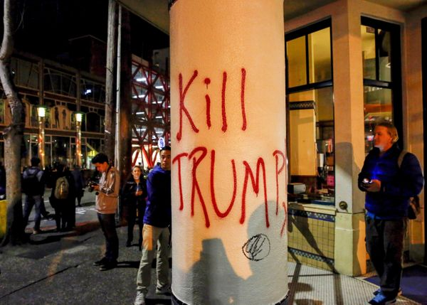 A spray painting reading 'Kill Trump' is seen during a protest at Sproul Hall.