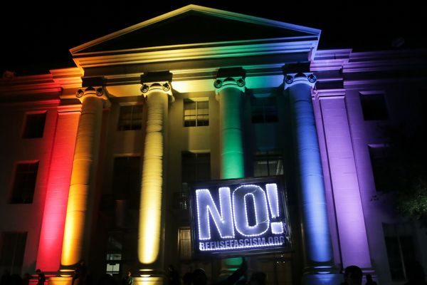 Rainbow colors light up a building at UC Berkeley.