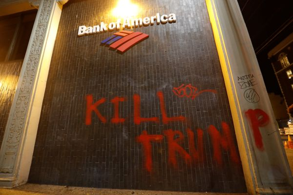 A vandalized Bank of America office is seen after a student protest turned violent at UC Berkeley.
