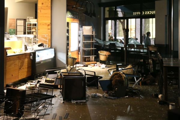 The inside of a Starbucks is seen after being looted by protesters.