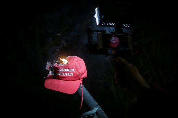 A 'Make America Great Again'' hat is burned on the UC Berkeley campus.