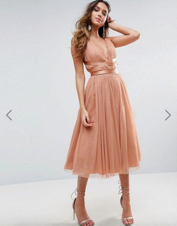 "<a href=""http://us.asos.com/asos/asos-premium-tulle-midi-prom-dress-with-ribbon-ties/prd/7277739?iid=7277739&clr=Peach&am"