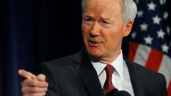 Former Rep. Asa Hutchinson (R-AR), a consultant of the National Rifle Association, discusses the findings and recommendations of the National School Shield Program at the National Press Club in Washington April 2, 2013.    REUTERS/Gary Cameron  (UNITED STATES - Tags: POLITICS EDUCATION)