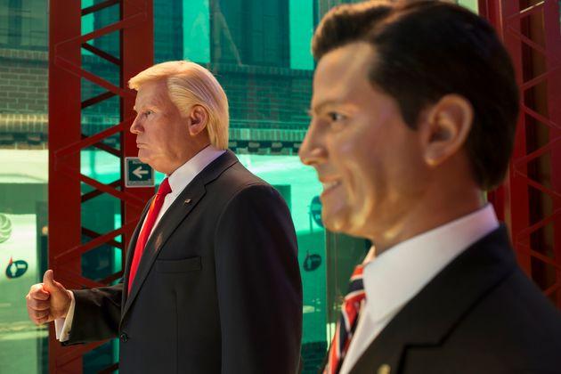 Wax replicas of U.S. President Donald Trump andMexican President Enrique Peña Nieto on display...