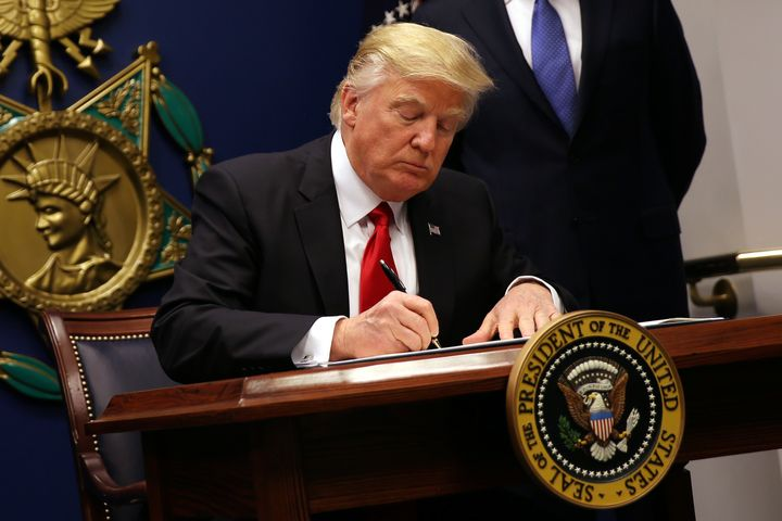 U.S. President Donald Trump signs an executive order to impose tighter vetting of travelers entering the United States, at th