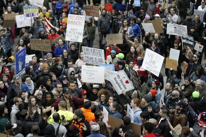 Activists gather at Portland International Airport to protest against President Donald Trump's executive action travel ban in