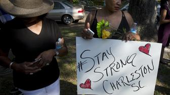 "People take part in a ""Black Lives Matter"" march around Emanuel African Methodist Episcopal Church in Charleston, June 20, 2015. Dylann Roof, a 21-year-old with a criminal record, is accused of killing nine people at a Bible-study meeting in the historic African-American church in Charleston, South Carolina, in an attack U.S. officials are investigating as a hate crime.      REUTERS/Carlo Allegri"
