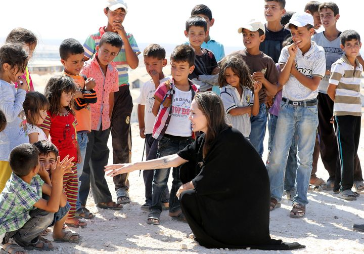 Jolie talks to children during a visit to a Syrian refugee camp in Azraq in northern Jordan, on Sept. 9, 2016.