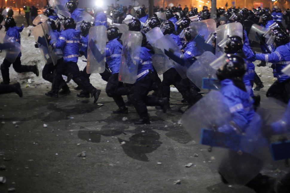 Romanian police charge at protesters in Bucharest, Romania, on Feb. 1, 2017.