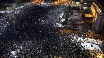 BUCHAREST, Feb. 2, 2017 -- People protest in front of the government headquarters against the new Criminal Codes in Bucharest, capital of Romania, Feb. 1, 2017. The Romanian government faced heavy pressure on Wednesday, with the head of state, oppositions and street protesters demanding to repeal freshly adopted emergency ordinance on Criminal Codes. (Xinhua/Gabriel Petrescu via Getty Images)