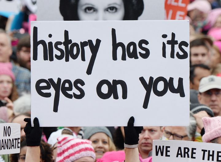 A sign from the Women's March on Washington, which occurred before President Trump signed his executive order restricting ref