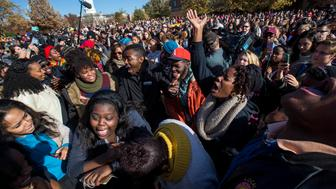 COLUMBIA, MO - NOVEMBER 9:  Protesters celebrate after the resignation resignation of Missouri University president Timothy M. Wolfe on the Missouri University Campus November 9, 2015 in Columbia, Missouri. Wolfe resigned after pressure from students and student athletes over his perceived insensitivity to racism on the university campus.  (Photo by Brian Davidson/Getty Images)