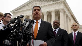 University of Texas President Gregory Fenves speaks outside the U.S. Supreme Court in Washington December 9, 2015. The U.S. Supreme Court on Wednesday appeared closely divided over the future of affirmative action in college admissions as the justices considered a challenge to the process for picking students used by the University of Texas at Austin.  REUTERS/Kevin Lamarque