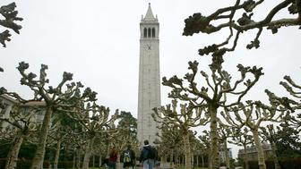 BERKELEY, CA - FEBRUARY 24:  Students walk near Sather Tower on the University of California at Berkeley campus February 24, 2005 in Berkeley, California. The City of Berkeley is suing U.C. Berkeley citing that university administrators did not adequately evaluate the consequences to the city with its 15-year growth plan and hopes to block construction of any new projects.  (Photo by Justin Sullivan/Getty Images)