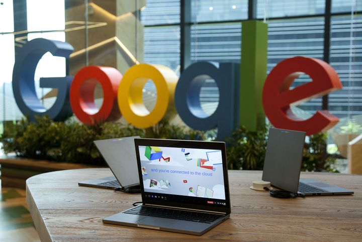 Google Inc. Chromebook laptop computers sit on displayat the company's Asia-Pacific headquarters during its opening day
