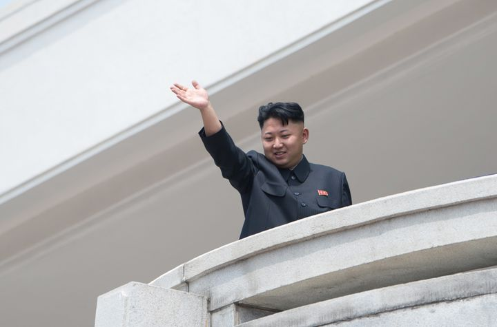 North Korean leader Kim Jong Un waves to the crowd during a military parade at Kim Il-Sung square marking the 60th anniversar