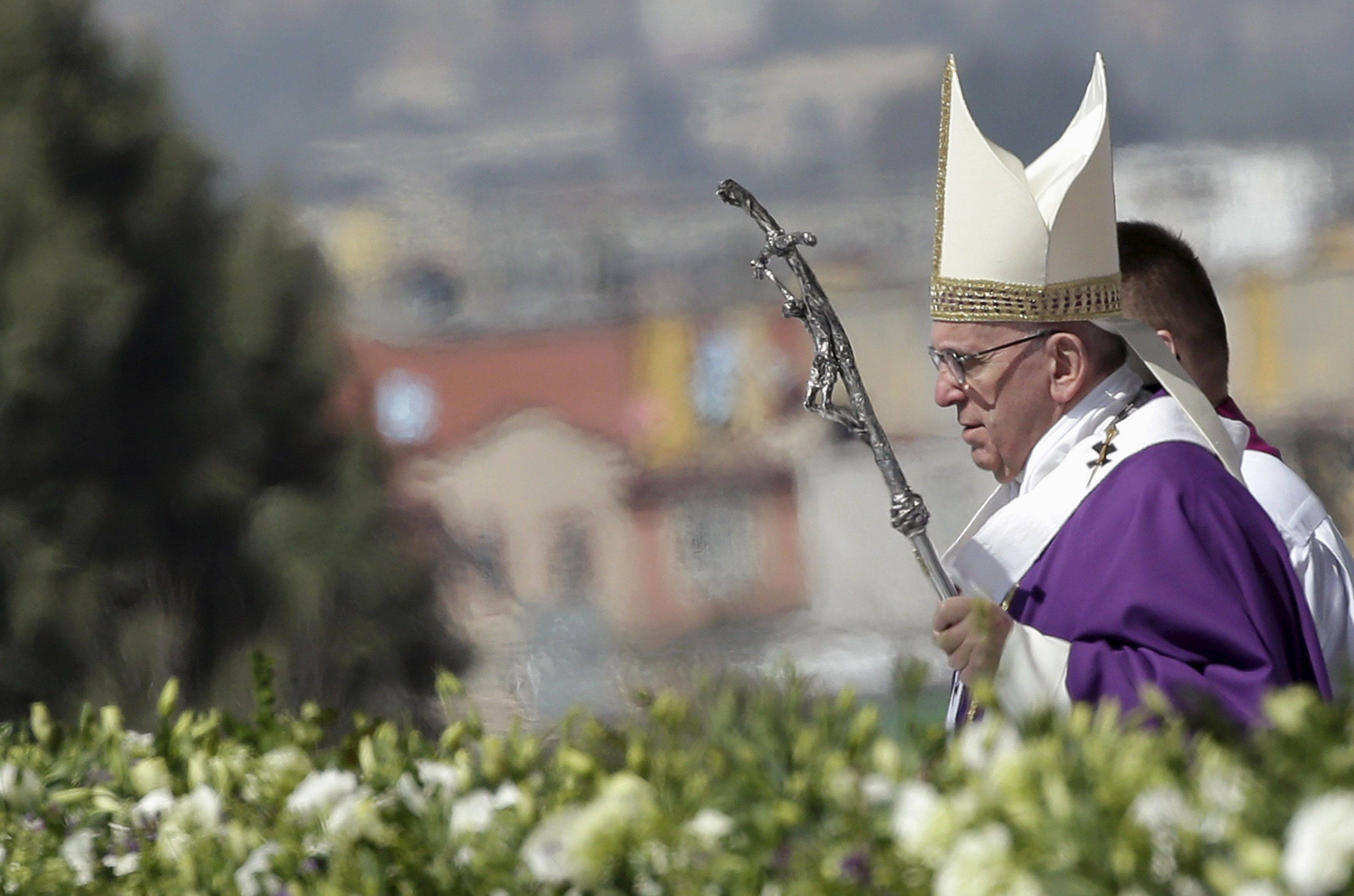 Pope Francis celebrates a Mass before a crowd of hundreds of thousands in Ecatepec, Mexico.