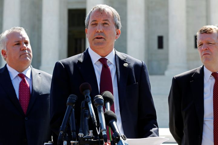 Texas Attorney General Ken Paxton holds a news conference.
