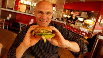 Andy Puzder, President of CKE Restaurants at a Carls Jr. Restaurant in Carpinteria with a turkey burger, as sales have been increasing at Carl's, Jr., restaurants over the past few months with CKE reporting earnings on June 28.  (Photo by Al Seib/Los Angeles Times via Getty Images)