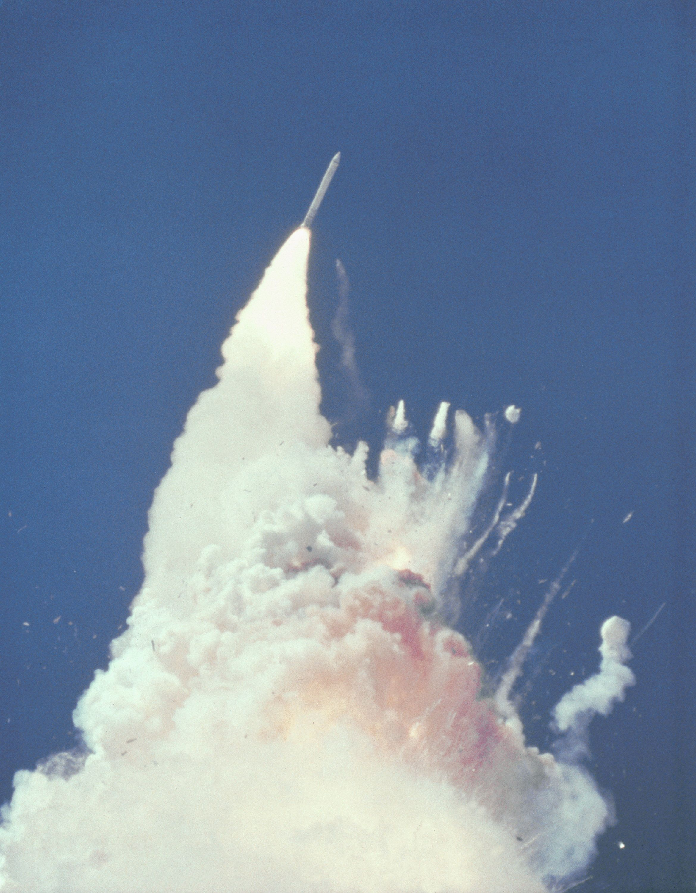 Fragments of the Space Shuttle Challenger Orbiter can be seen tumbling against a background of fire, smoke and vaporized propellants from the External Tank after liftoff from the Kennedy Space Center in this NASA handout photo dated January 28, 1986. The left Solid Rocket Booster (SRB) flies rampant, still thrusting. The reddish-brown cloud envelops the disintegrating Orbiter. The color is indicative of the nitrogen tetroxide oxidizer propellant in the Orbiter Reaction Control System. REUTERS/NASA/Handout  (UNITED STATES - Tags: SCI TECH DISASTER) FOR EDITORIAL USE ONLY. NOT FOR SALE FOR MARKETING OR ADVERTISING CAMPAIGNS. THIS IMAGE HAS BEEN SUPPLIED BY A THIRD PARTY. IT IS DISTRIBUTED, EXACTLY AS RECEIVED BY REUTERS, AS A SERVICE TO CLIENTS