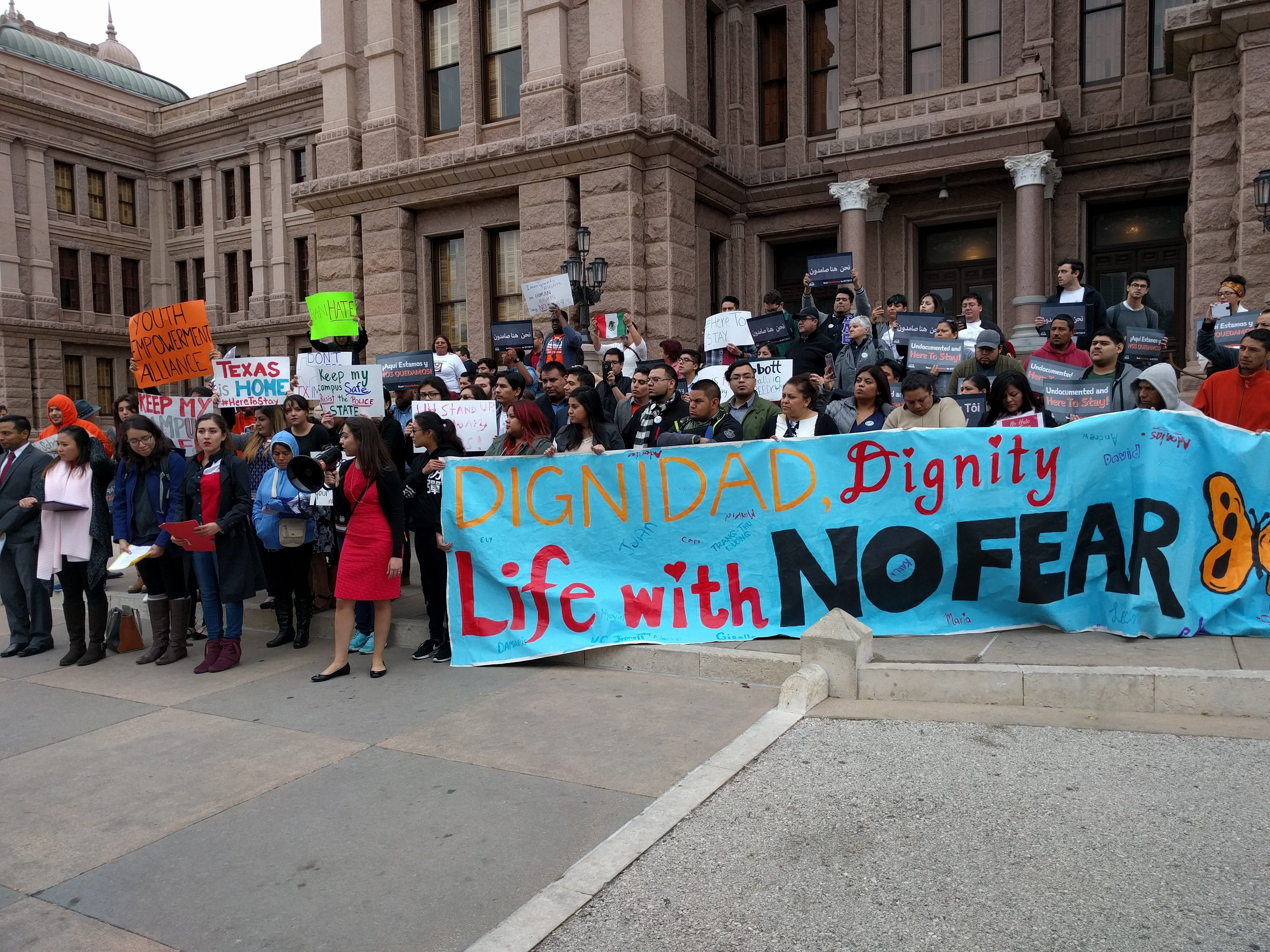 Undocumented youths with United We Dream protest on the steps of the Texas legislature against a bill that would crackdown on sanctuary cities