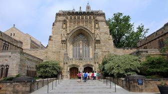 New Haven, Connecticut - June 1, 2011:  a tour group of students at the entrance to Sterling Memorial Library of Yale University