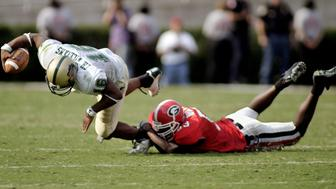University of Alabama at Birmingham quarterback Chris Williams (L) is sacked by University of Georgia linebacker Derrick White late in the fourth quarter to end UAB's chance to tie the game at Sanford Stadium in Athens, Georgia, October 25, 2003. Georgia defeated the University of Alabama in Birmingham, 16-13. REUTERS/Tami Chappell  TLC