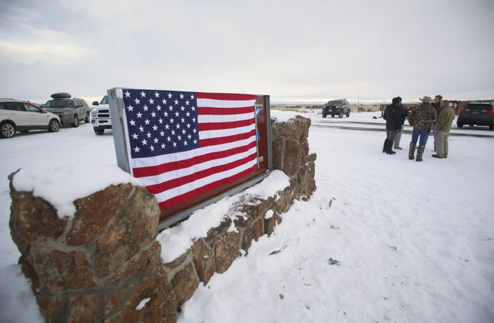A U.S. flag covers a sign at the entrance of the Malheur National Wildlife Refuge near Burns, Oregon.