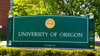 Eugene, OR, USA - April 29, 2014: University of Oregon campus entrance sign next to a walkway at the school.