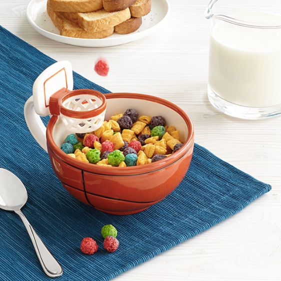 """<a href=""""http://www.uncommongoods.com/product/the-mug-with-a-hoop"""" target=""""_blank"""">The mug with a hoop</a>, $24 at <a href=""""h"""