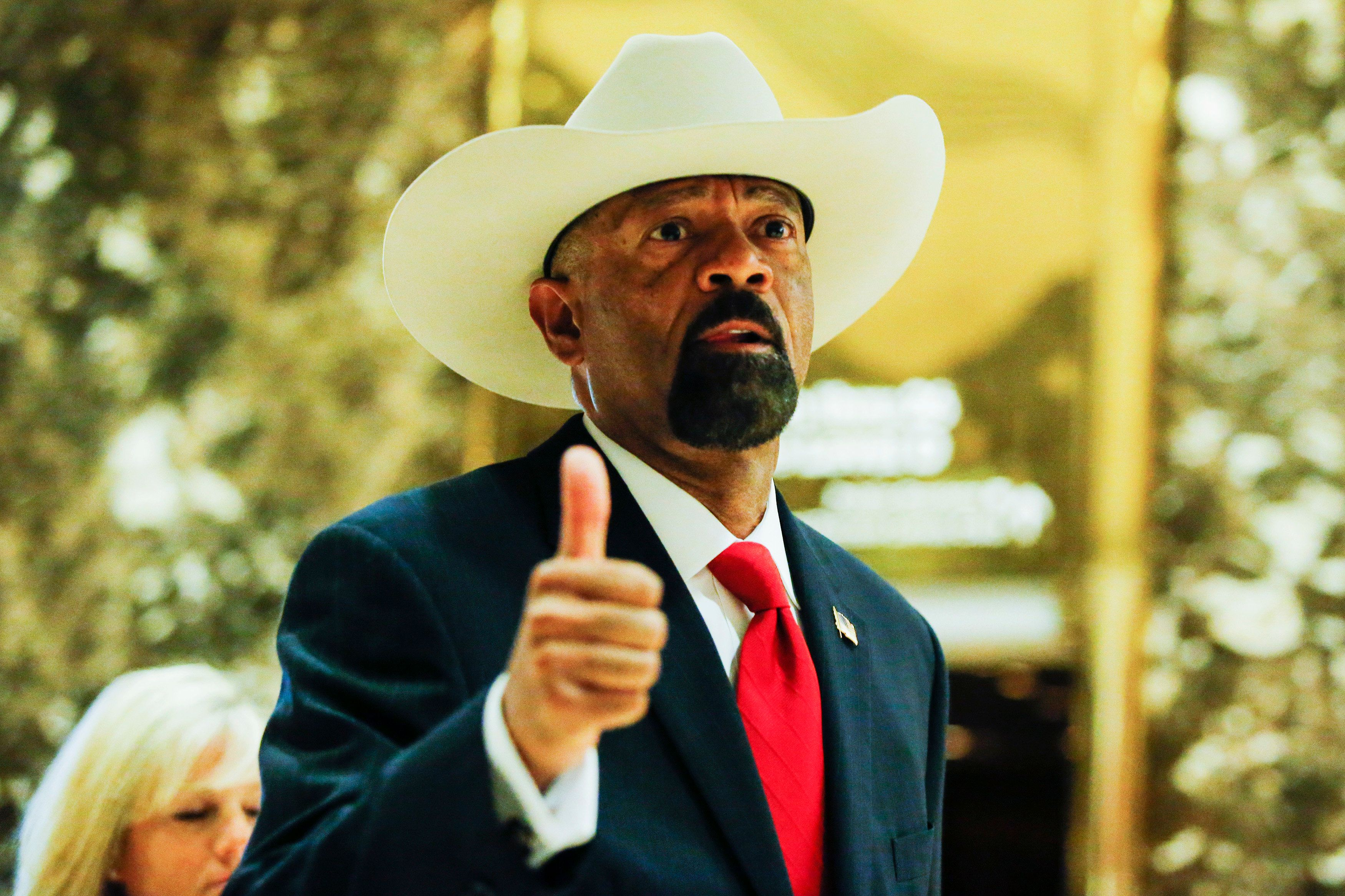 Milwaukee Sheriff David Clarke (L) exits elevators after meetings with President-elect Donald Trump November 28, 2016 at the Trump Tower in New York / AFP / Eduardo Munoz Alvarez        (Photo credit should read EDUARDO MUNOZ ALVAREZ/AFP/Getty Images)