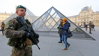 Armed French soldiers patrol at the Louvre Museum as emergency security measures continue ahead of New Year's eve celebrations in and around the French capital, in Paris, France, December 30, 2016.   REUTERS/Jacky Naegelen